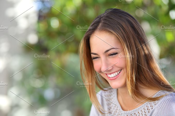 Beautiful woman laughing happy outdoor.jpg - Beauty & Fashion