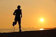 Backlight of a men running on the beach at sunset.jpg
