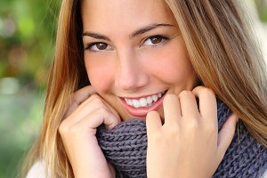 Close up of a beautiful woman smile outdoor.jpg