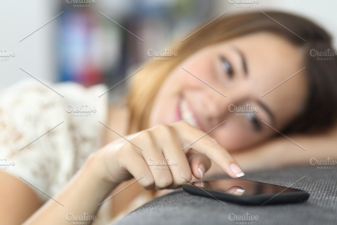 Close up of a woman hand touching a smart phone at home.jpg - Technology