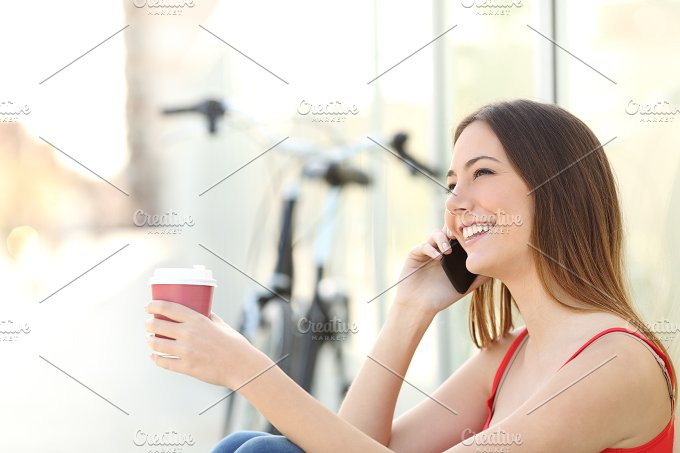 Girl calling on the mobile phone and drinking coffee.jpg - Technology