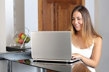 Girl working with a laptop at home.jpg