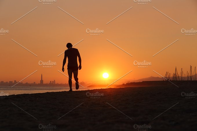 Jogger silhouette walking exhausted after a hard training.jpg - Sports