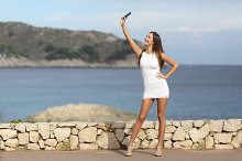 Sexy woman photographing a selfie with a smart phone.jpg