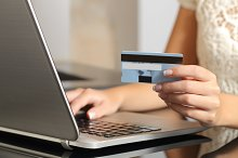Woman buying online with a credit card.jpg