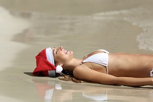 Woman relaxing on the beach on christmas holidays.jpg