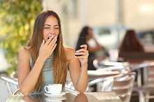 Woman yawning while is working at breakfast in a restaurant.jpg