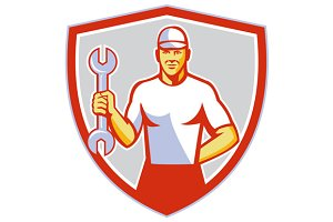 Mechanic Holding Wrench Crest Retro