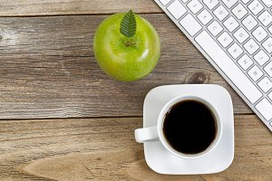 Black coffee and snack on desktop
