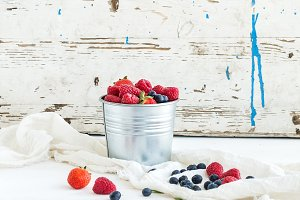 Metal bucket of berries