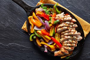 chicken fajitas in skillet overhead