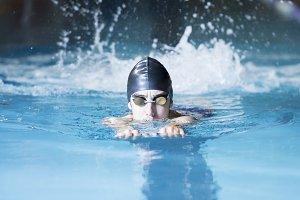 swimmer swimming with a swim board