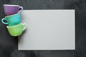 Blank sheet of paper and vintage cup