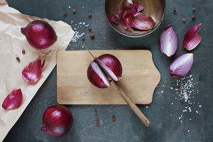 Red onion on the wooden table