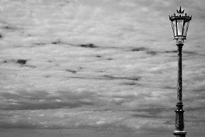 Streetlight and cloudy skies (b/w)