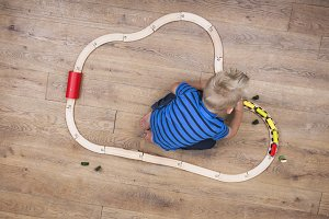 Boy playing with his train set