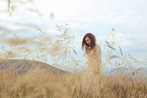 Woman in a long dress in a field