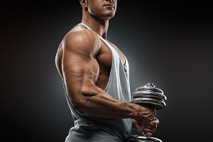Bodybuilder pumping up muscles