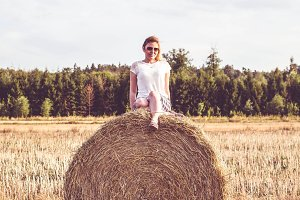 Girl on a hay bale