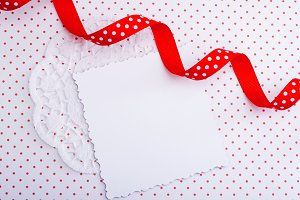 Decorative card with red ribbon