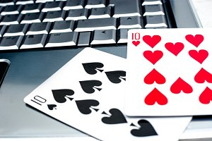 Laptop and poker cards