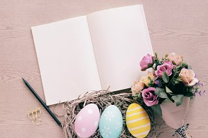 Pastel easter eggs and blank book