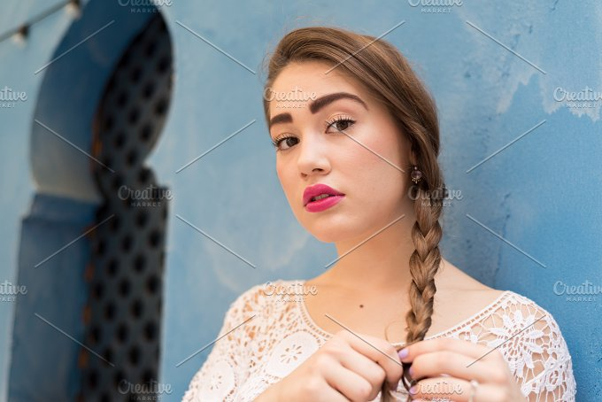 Plaiting her Hair while looking at Camera.jpg - People