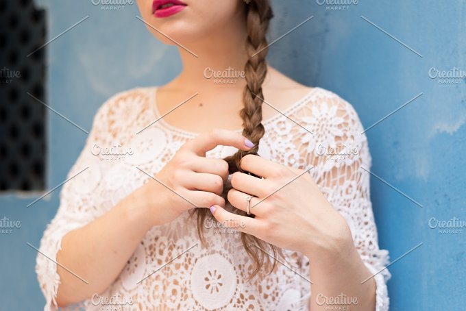 Plaiting her Hair while_.jpg - People