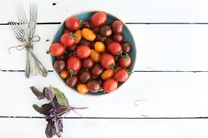 Cherry tomatoes in blue ceramic bowl