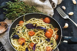 Pasta with pesto, basil and tomatoes
