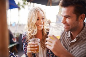 couple drinking in outdoor pub
