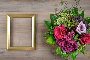 Golden picture frame and rose flower