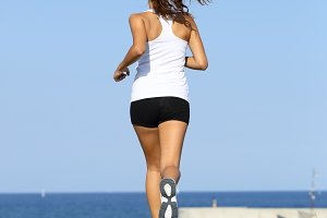 Back view of a young woman running.jpg