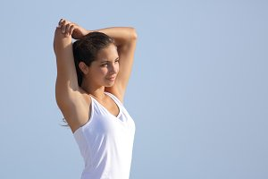 Beautiful woman stretching with the sky in the background.jpg