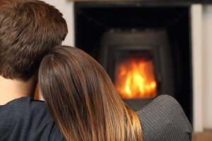 Couple at home resting near fire place.jpg