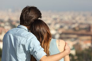 Couple dating in love and hugging watching the city.jpg