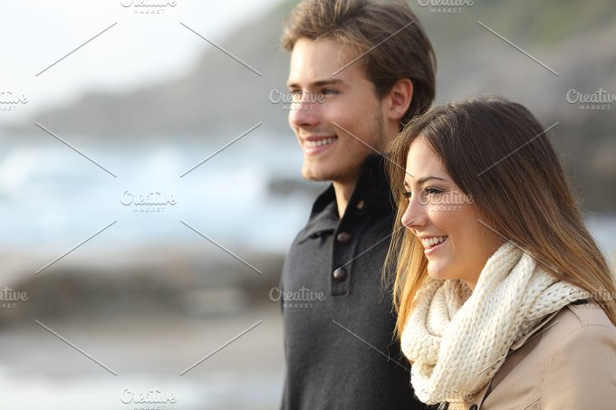 Couple in winter looking away on the beach.jpg - People