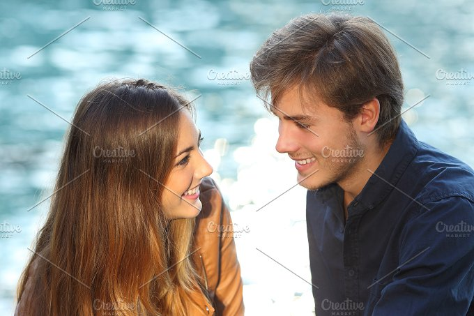 Couple looking each other in love on vacations.jpg - People