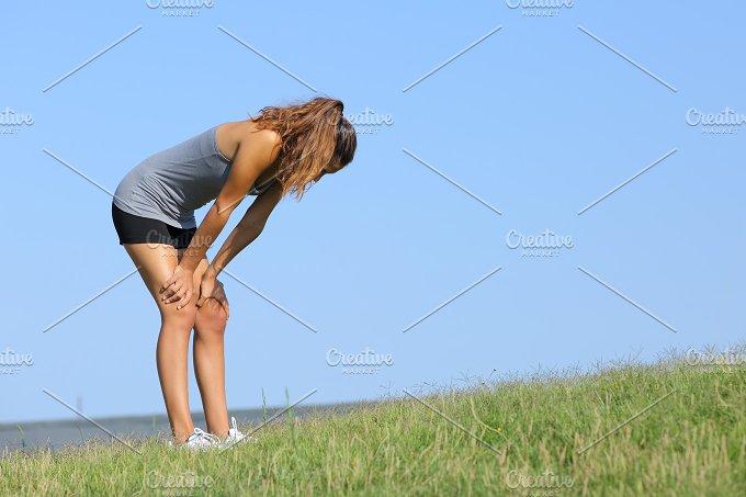 Fitness woman tired resting.jpg - Sports