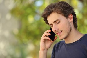 Handsome man talking on the mobile phone.jpg