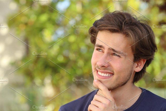 Happy man thinking outdoor.jpg - Beauty & Fashion