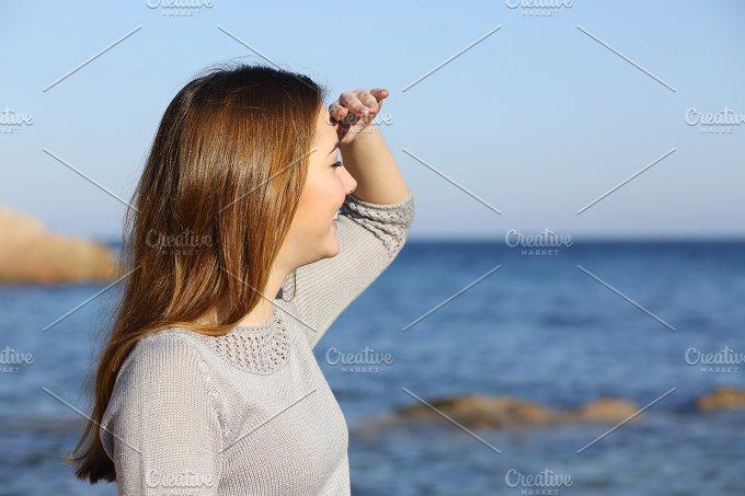 Happy woman looking forward at the horizon.jpg - Nature