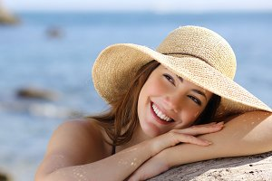 Happy woman with white smile looking sideways on vacations.jpg