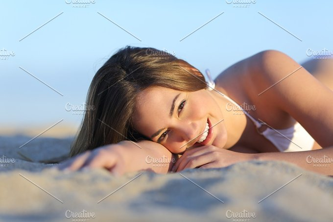 Portrait of a Beautiful woman sunbathing lying on the beach.jpg - Beauty & Fashion