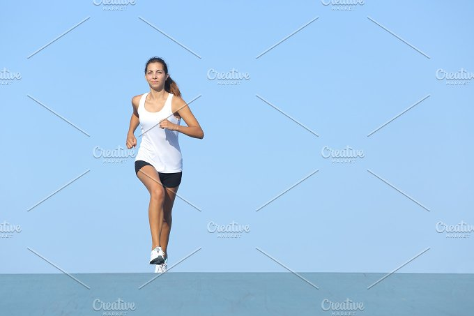 Runner woman running alone.jpg - Sports