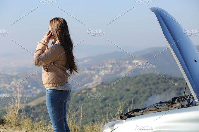 Woman on the phone asking for assistance beside her crashed breakdown car.jpg - Transportation
