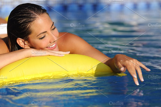 Woman bathing and playing with water on a swimming pool in vacations.jpg - Beauty & Fashion