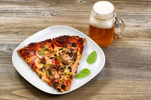 Pizza slices and beer