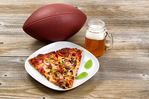 Football with beer and pizza