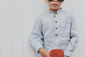 Serious small boy in modern sunglass